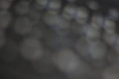 Bokeh de lumière sur le fond gris Photographie stock libre de droits