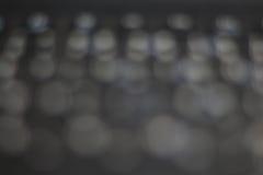 Bokeh de lumière sur le fond gris Image stock