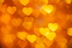 Bokeh de oro del fondo de los corazones Imagen de archivo