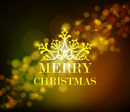 Bokeh de oro del vintage del ornamento de la Feliz Navidad Imagen de archivo