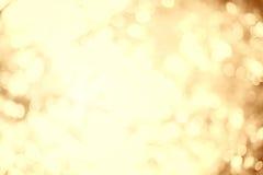 Bokeh de oro en el concepto de la luz blanca para el fondo de la Navidad Foto de archivo