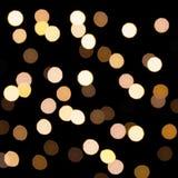 Bokeh de oro en un fondo oscuro Lignts Defocused del bokeh Fondo abstracto de la Navidad Fondo circular abstracto del bokeh del C Imagen de archivo