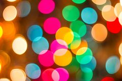 Bokeh Decorative outdoor string lights hanging on a tree in the garden at night time. Decorative Christmas lights - happy new year Royalty Free Stock Image