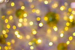 Bokeh Decorative outdoor string lights hanging on a tree in the garden at night time. Decorative Christmas lights - happy new year Royalty Free Stock Images