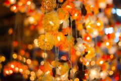 Bokeh Decorative outdoor string lights hanging on a tree in the garden at night time. Decorative Christmas lights - happy new year Stock Photography