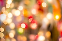 Bokeh Decorative outdoor string lights hanging on a tree in the garden at night time. Decorative Christmas lights - happy new year Royalty Free Stock Photo