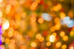 Decorative outdoor string lights hanging on tree in the garden at night time - decorative christmas lights. Bokeh Decorative outdoor string lights hanging on royalty free stock photos