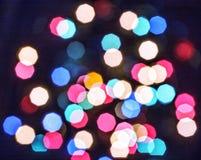 Bokeh Defocused, abstrakt som är mångfärgad, bakgrund, ljus, modell, abstrakt begrepp, suddighet som är ljus, jul Arkivfoton