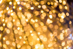 Bokeh defocused gold. Christmas background Royalty Free Stock Photos