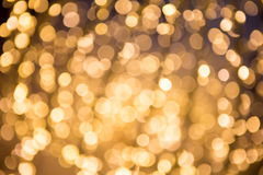 Bokeh defocused Goldzusammenfassungshintergrund Stockfotografie