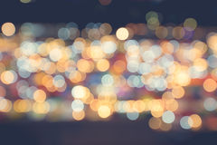Bokeh. Defocused Bokeh twinkling lights Vintage background. Festive background with natural bokeh and bright golden lights Royalty Free Stock Photos