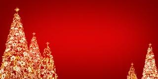 Bokeh del árbol de navidad en fondo rojo Foto de archivo libre de regalías