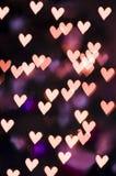 Bokeh del corazón - fondo del día de tarjeta del día de San Valentín Foto de archivo libre de regalías