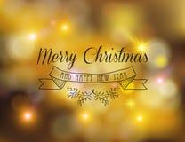 Bokeh del oro del ornamento de la etiqueta del Año Nuevo de la Feliz Navidad Imagen de archivo