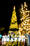 Bokeh dell'albero di Natale e del testo felici Immagini Stock