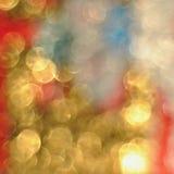 Bokeh delle luci dorate defocused, fondo astratto Immagini Stock