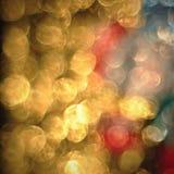 Bokeh delle luci dorate defocused, fondo astratto Immagine Stock Libera da Diritti