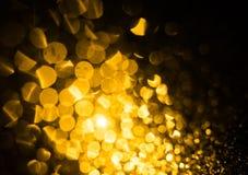 Bokeh delle luci gialle del fondo vago estratto Fotografia Stock