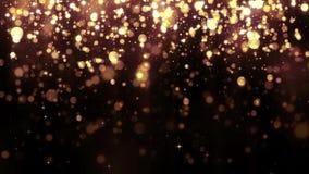 Bokeh di caduta delle particelle di scintillio dorato del fondo Bella priorità bassa chiara Luce magica di caduta della particell archivi video