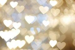 Bokeh di galleggiamento di forma del cuore dell'oro Fotografia Stock Libera da Diritti