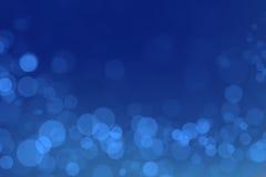Bokeh di miracolo con il fondo blu di pendenza fotografia stock libera da diritti