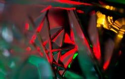 Bokeh di vetro illuminato del modello sopra buio Fotografia Stock