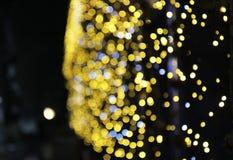 Bokeh do fundo da decoração do Natal da incandescência das luzes Foto de Stock