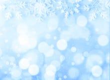 Bokeh do Natal no fundo azul fotos de stock