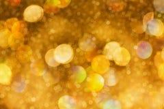 Bokeh dourado da faísca e do sopro Imagens de Stock Royalty Free