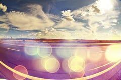 Bokeh du soleil de route d'été Images stock