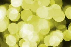 Bokeh effect golden yellow defocused light background. Christmas Lights Concept.  Royalty Free Stock Image