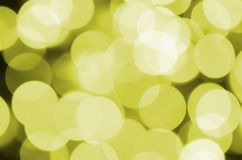 Bokeh effect golden yellow defocused light background. Christmas Lights Concept.  Stock Image