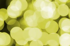 Bokeh effect golden yellow defocused light background. Christmas Lights Concept.  Royalty Free Stock Images