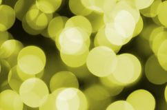 Bokeh effect golden yellow defocused light background. Christmas Lights Concept.  Stock Photography