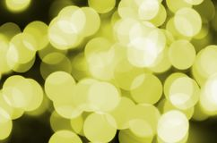 Bokeh effect golden yellow defocused light background. Christmas Lights Concept.  Royalty Free Stock Photos