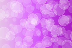Bokeh effect on a purple gradient Royalty Free Stock Image