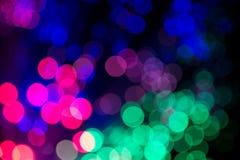 Bokeh färbte Lichter auf schwarzem Hintergrund Stockbild