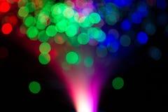 Bokeh färbte Lichter auf schwarzem Hintergrund Stockfotografie