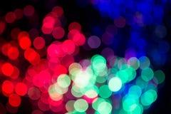 Bokeh färbte Lichter auf schwarzem Hintergrund Lizenzfreie Stockfotos