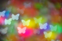 Bokeh färbte Schmetterlingslichter auf schwarzem Hintergrund Stockfotos