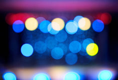 Bokeh of faded blurred stage lights. Congestion of faded colorful defocused large lights on dark background stock photography