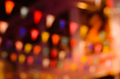 Bokeh of Fastival Flags In Blurred Background. Colorful of festival triangular flag on night time in blurred background Royalty Free Stock Photo