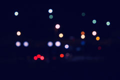 Bokeh and flare of blured urban night scene. Defocused city lights at night. Stock Photo