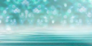 Bokeh Forest Turquoise Blue Background med vatten arkivfoto