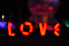 Bokeh form to LOVE words on black background Stock Photo