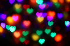 Bokeh in forma di cuore variopinto dei biglietti di S. Valentino sul bokeh nero di illuminazione del fondo per la decorazione al  Fotografia Stock Libera da Diritti