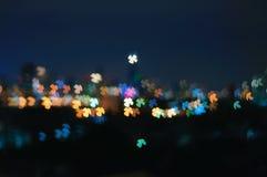 Bokeh Four Leaves Clover Shape Night  Light Background. Bokeh Night City Light Landscape Background In Small Colorful Four Leaves Clover Shape Glowing Lights Royalty Free Stock Images