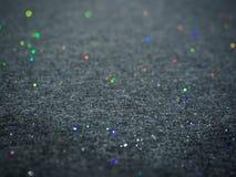 Bokeh glitter on grey cotton fabric texture stock photo