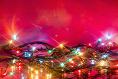Bokeh of glowing multicolored Christmas garlands reflected Royalty Free Stock Images