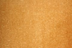 Bokeh from golden fabric stock photo